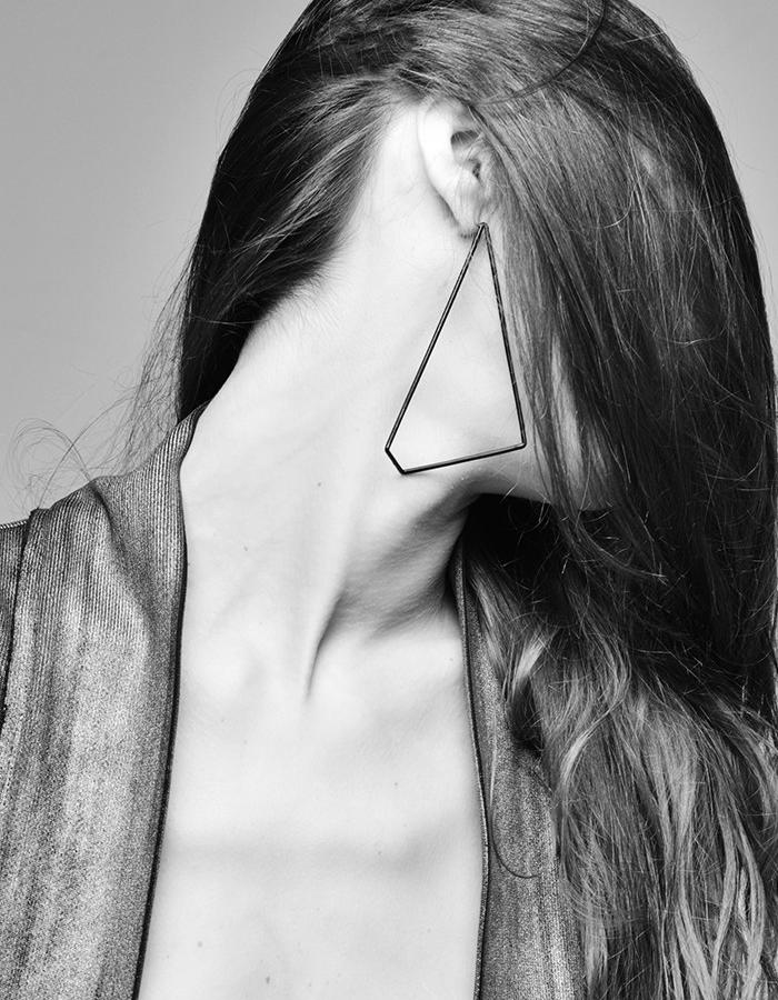 Handmade pair of earrings inspired by CCTV Tower in Beijing. Photo by Samantha Camozzi