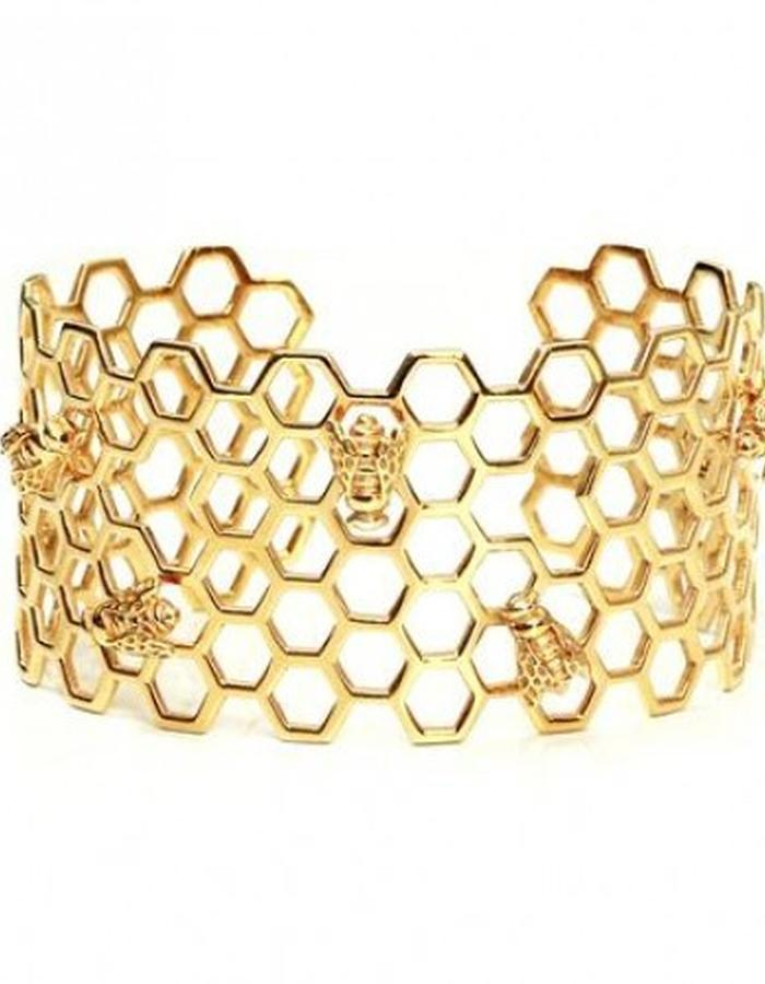 Gold honeycomb cuff with gold bees by Strange of London