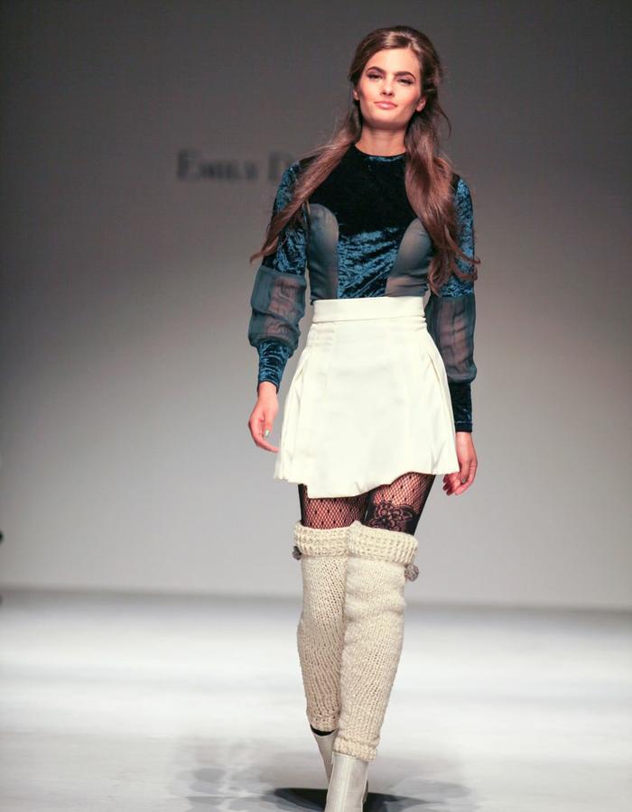 Sheer top and cream mini skirt