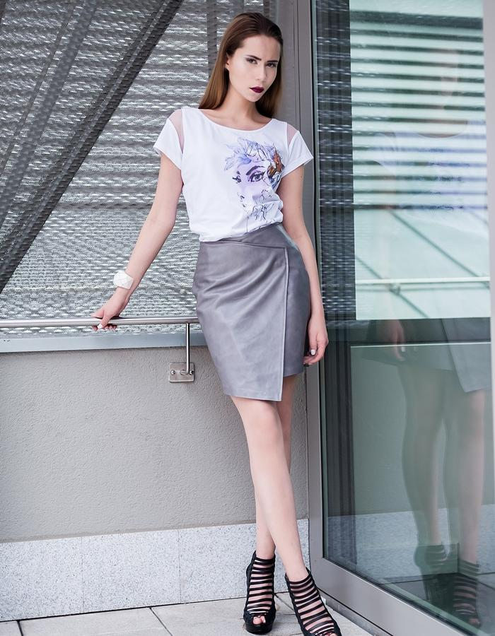 Illustrated cotton blouse and leather skirt