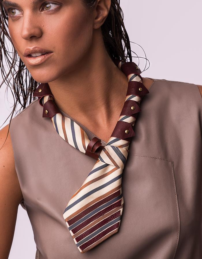 Woman wearing a fashion neck piece made from repurposed tie