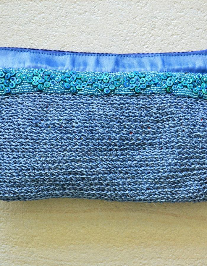 Fique fibre and leather beaded clutch bag