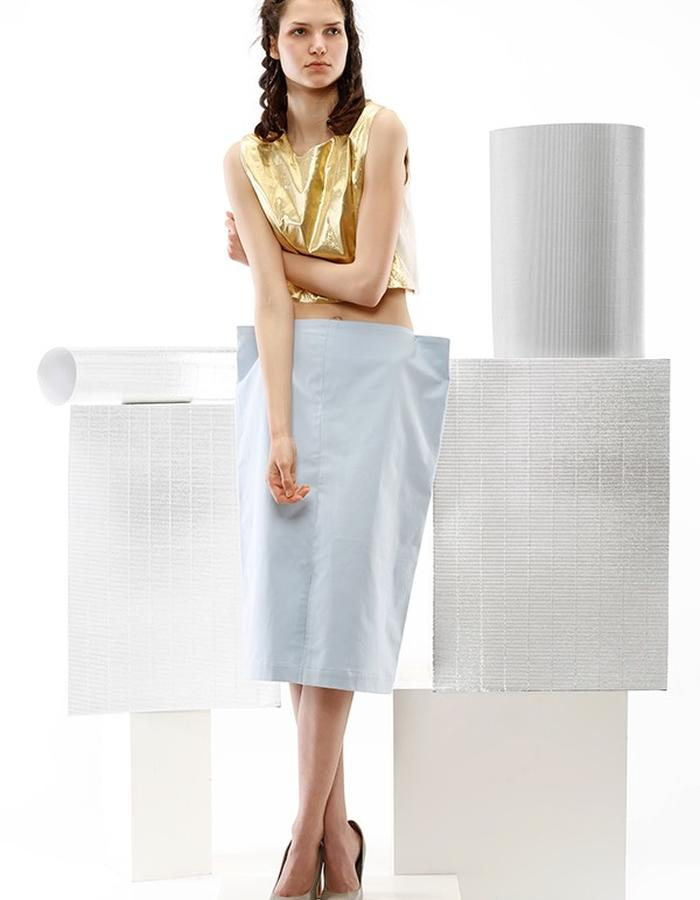 gold and beige top and geometric skirt