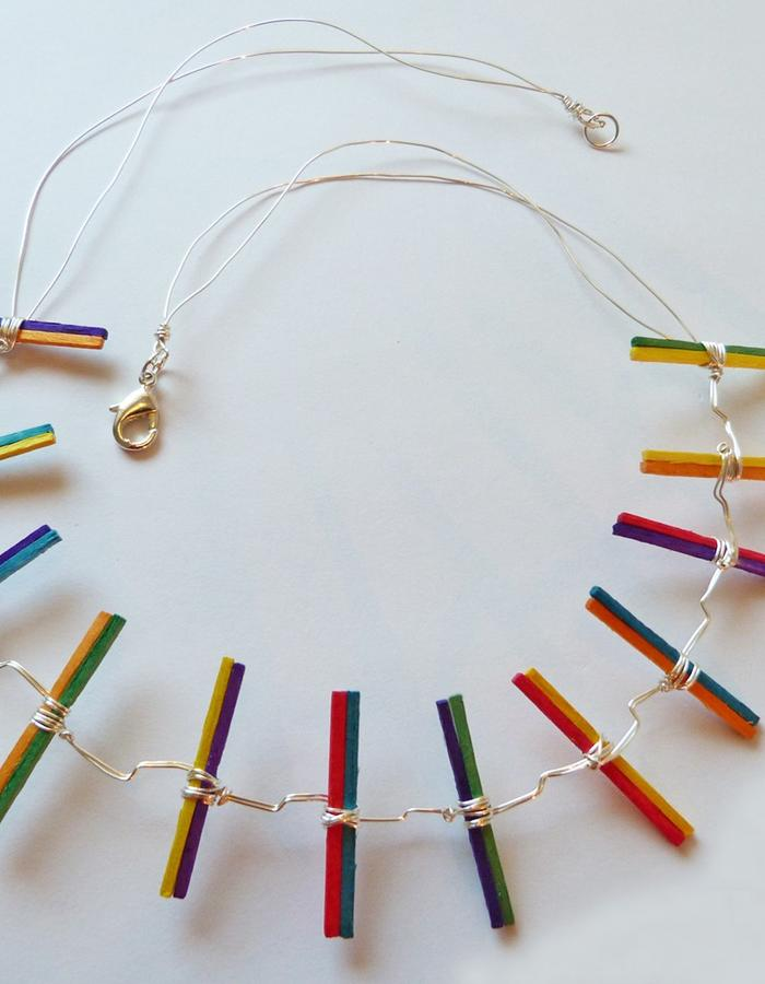 Rainbow necklace with sticks.