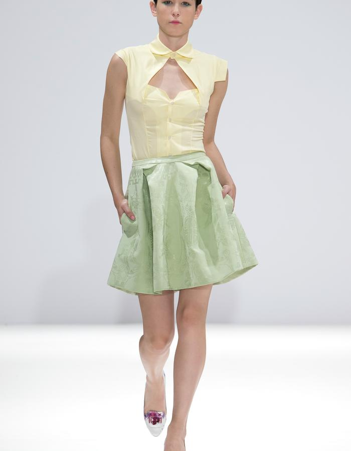 Ong-Oaj Pairam Spring Summer 15. Yellow fitted blouse. Embossed green skirt. Hand Painted and Japanese Stitched Court Shoes.