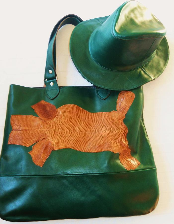 Leather green bag and green leather hat.