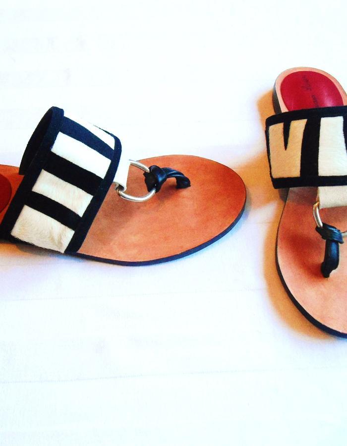 Leather sandals.Upper is zebra pony.