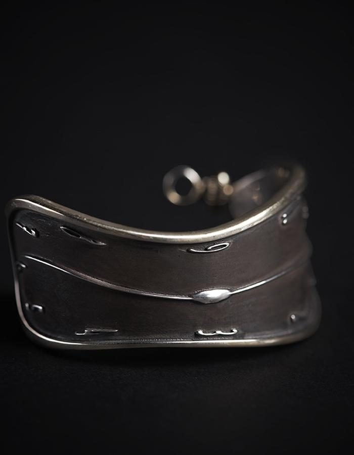 Melting watch cuff bracelet