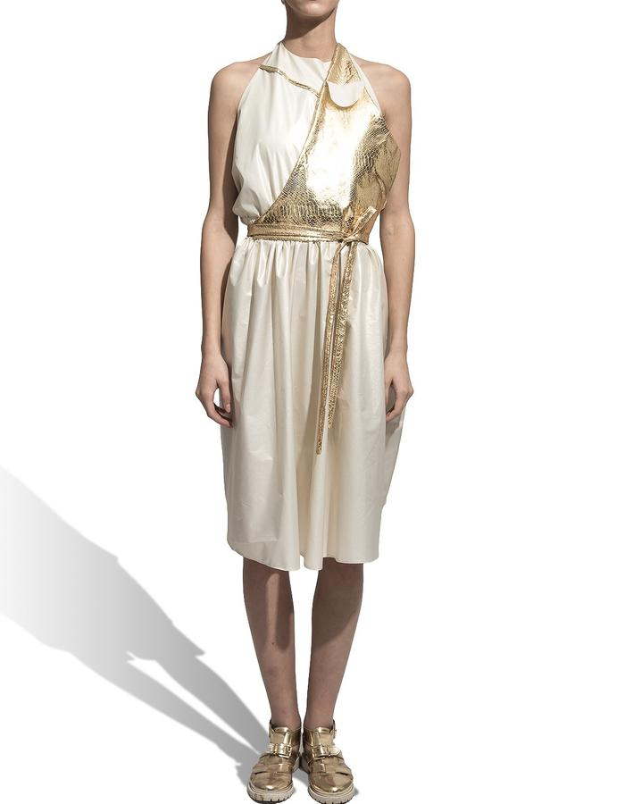 7. FRONT Product name : Gold Dress Product description: Backless midi dress with side pockets. The dress has a manoeuvrable gold flap with a long cord. (you can move the flap either up front or back). At the neckline it closes with an cotton string . Fabric: waterproof slicker, faux leather Fabric composition: 100 % synthetic. Cleaning and maintenance suggestions: dry cleaning Size: M / unique product