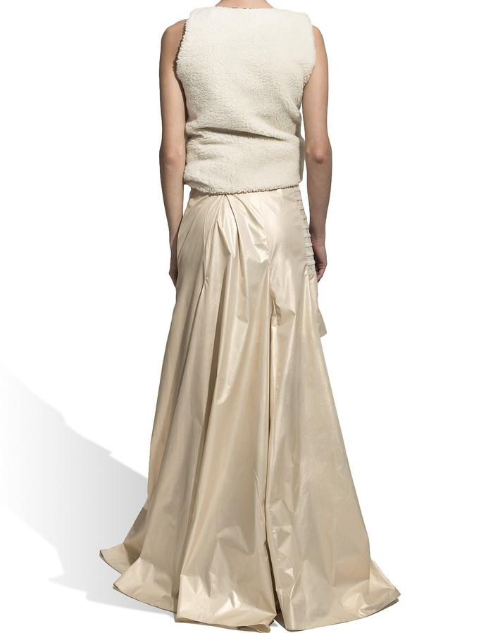 8. BACK Product name : Long Gold Skirt Product description: The skirt has a midi length in the front and a long back. Side pockets. Manoeuvrable flap.( you can close it either in front or back) Fabric: waterproof slicker, faux leather Fabric composition: 100 % synthetic. Cleaning and maintenance suggestions: dry cleaning Size: M / unique product