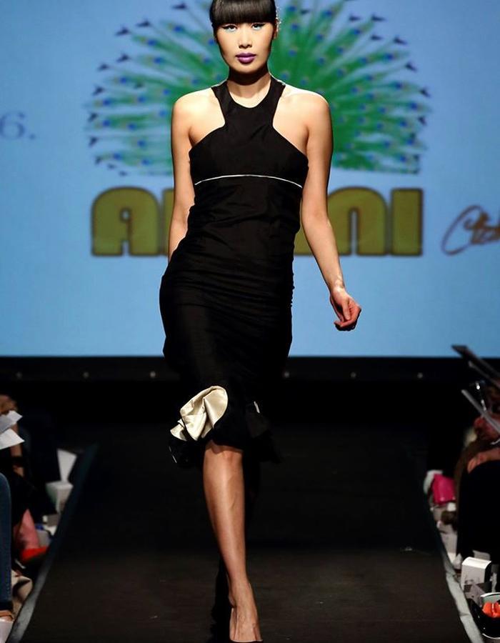 black satin dress with structured cream flower detail