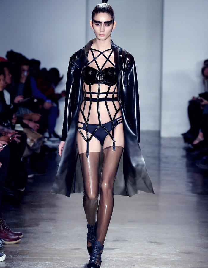 The Chromat Lucite Latex Coat, Patent Pentagram Bra and Patent Garter Cage Bustier, from the AW15: MINDFILES Collection