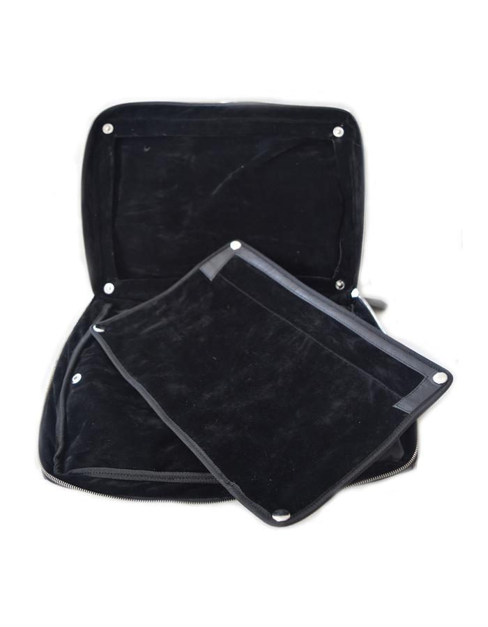 dinnaRo menbag, inside the bag