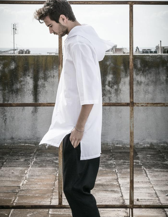 white hood shirt worn with drop crotch trousers