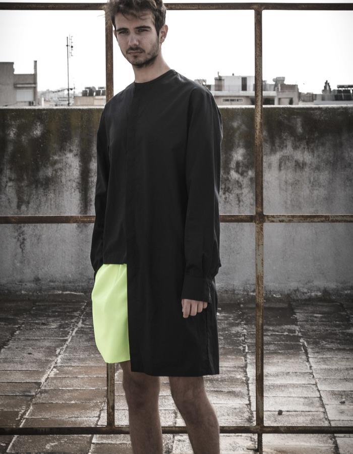 asymmetric shirt worn with neon shorts