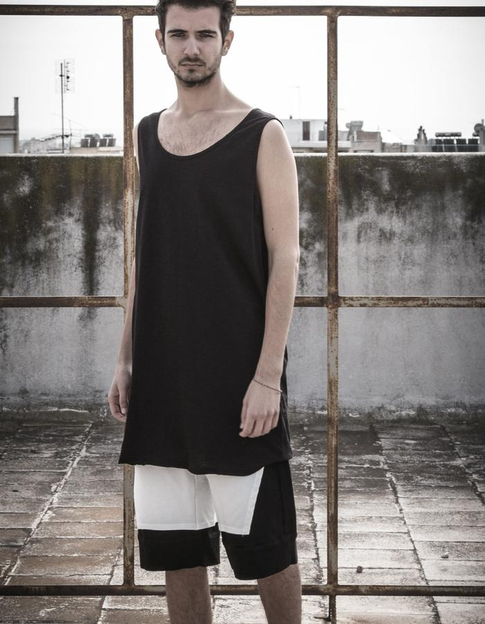 long tank top worn with double colour shorts
