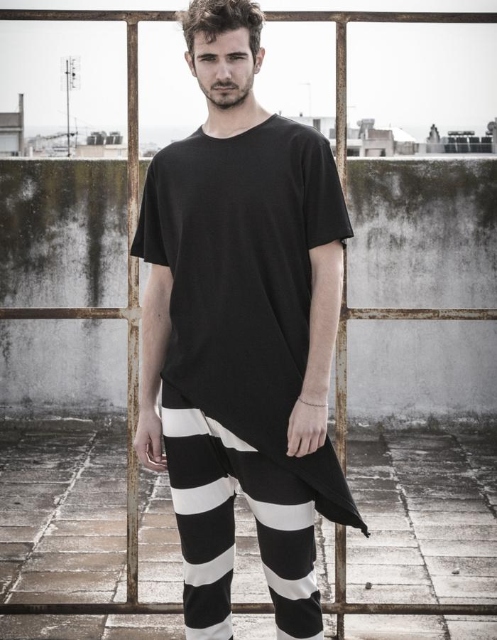 asymmetric t-shir worn with big stripes grandpa trousers