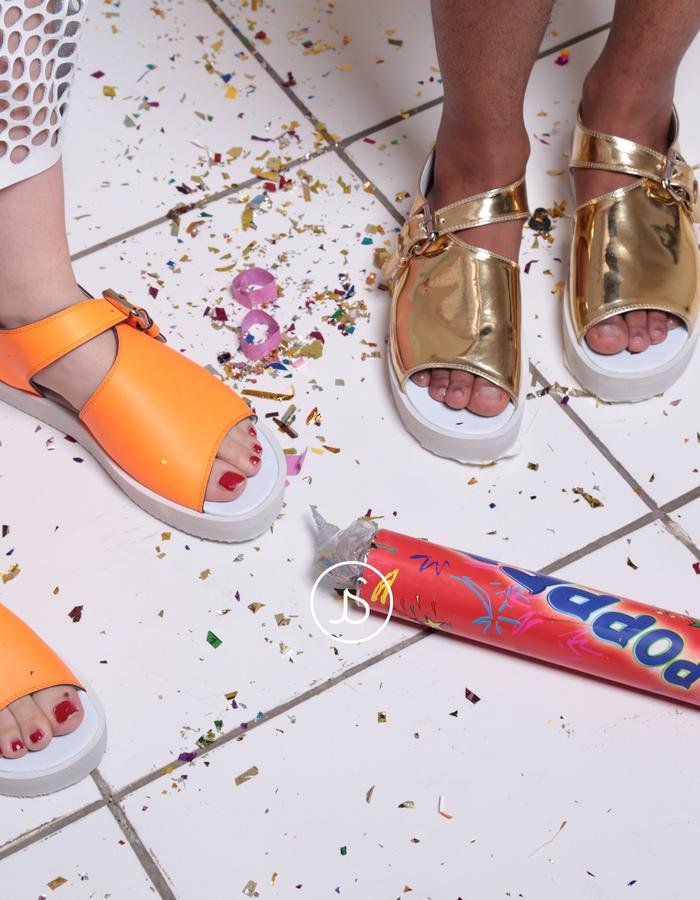 neon orange and gold sandals
