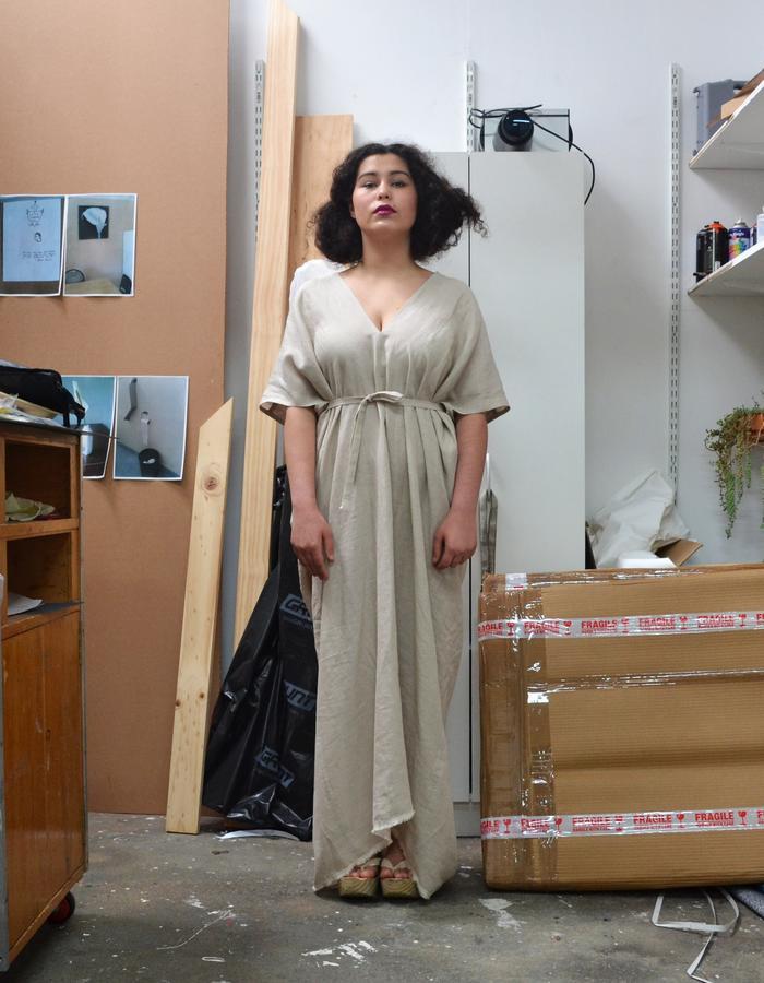 Floor-length reversible linen dress with box pleats and optional waist tie.