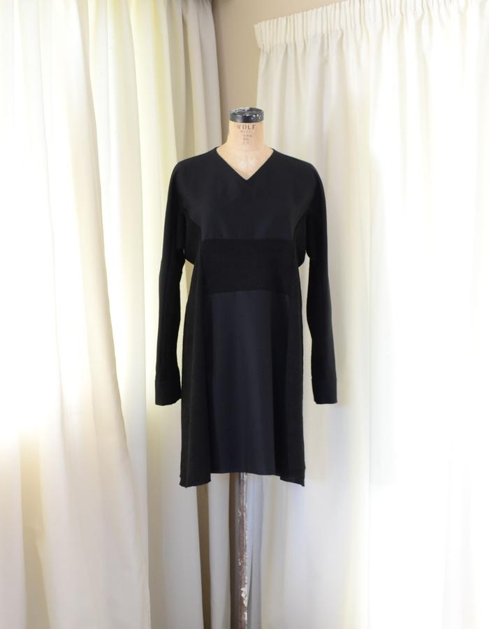 Panelled cotton and wool-knit v-neck dress with curved shoulder seams.