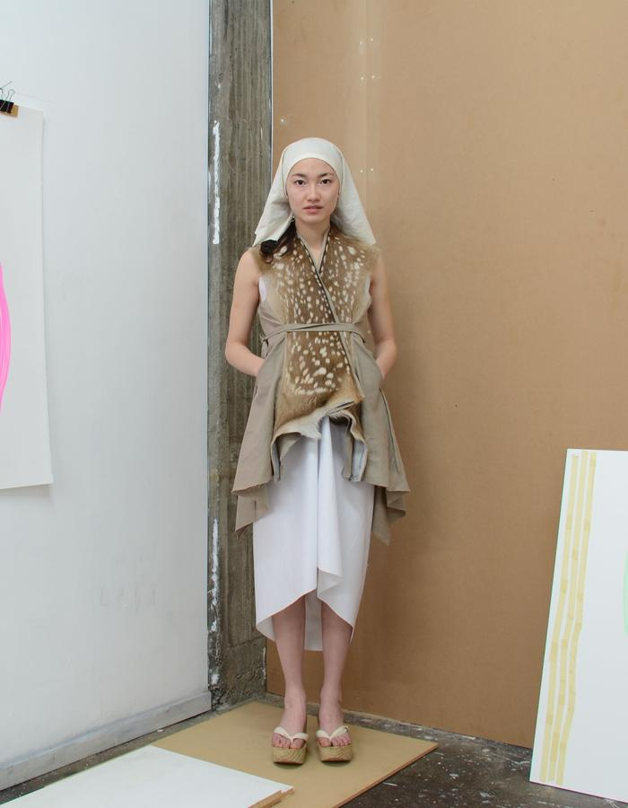Linen and locally hunted wild fawn vest with tie-closures. worn with white drape dress and pine platforms sandals.