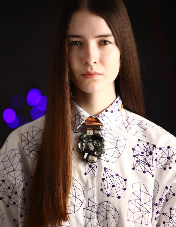 White cotton shirt with violet constellations embroidery.