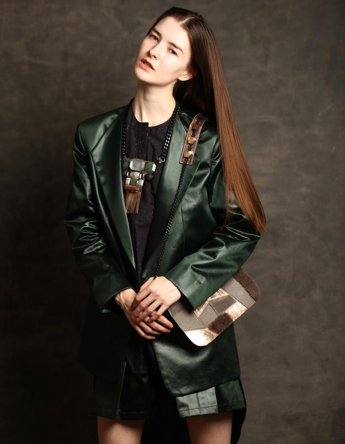 Leather finish coated green fabric suit with pleated shorts.