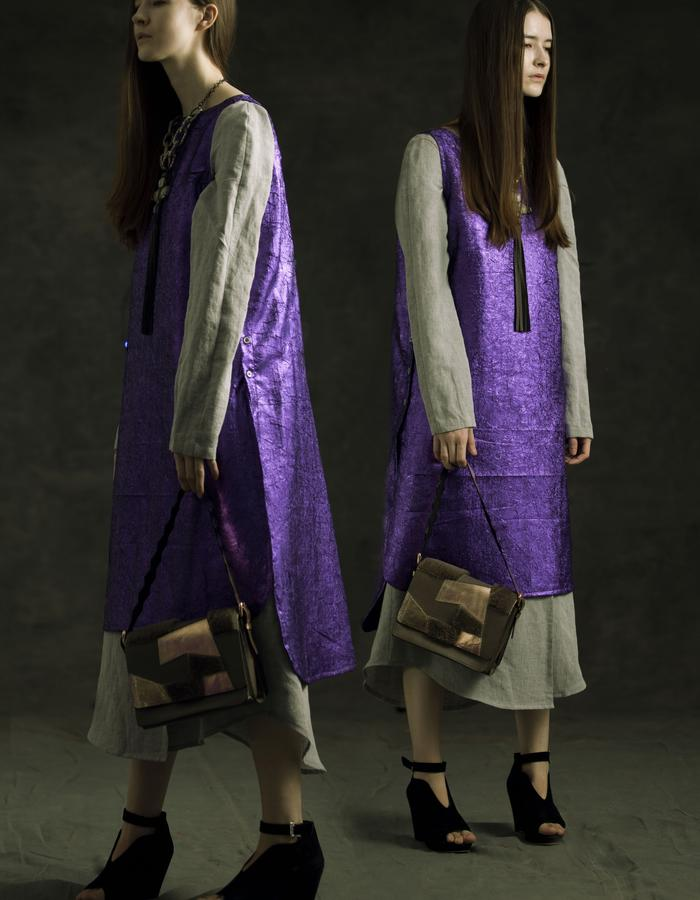 Oversized sleeveless violet overlay in wrinkled poly blend and grey linen wrap underdress.