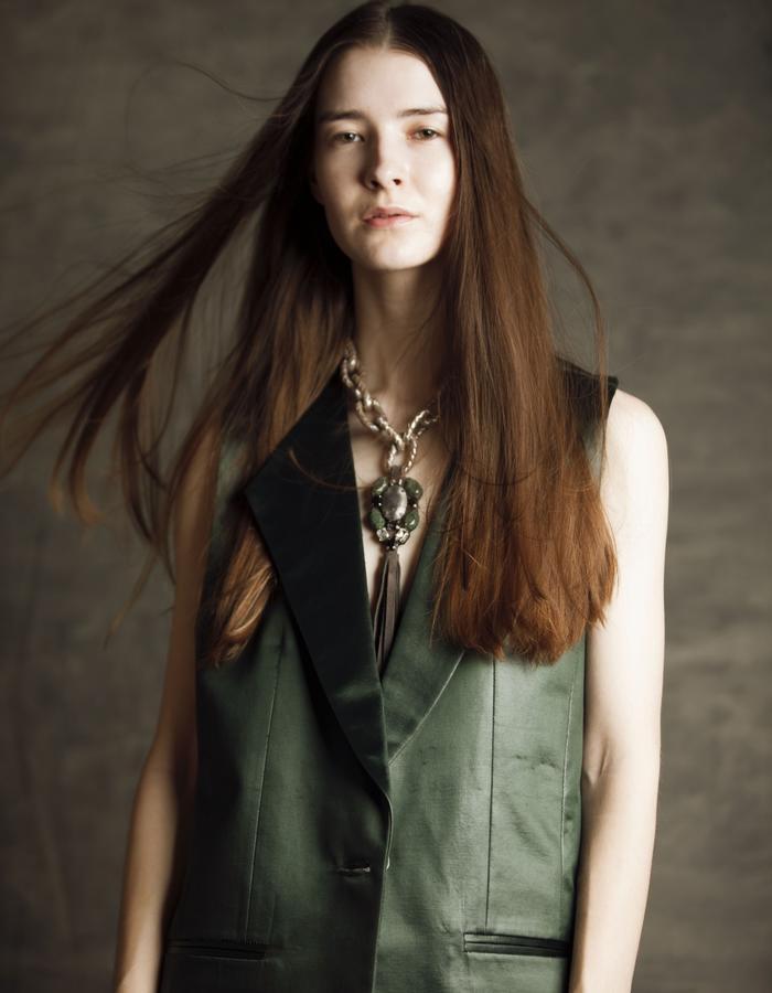 Leather finish coated green sleeveless suit blazer.