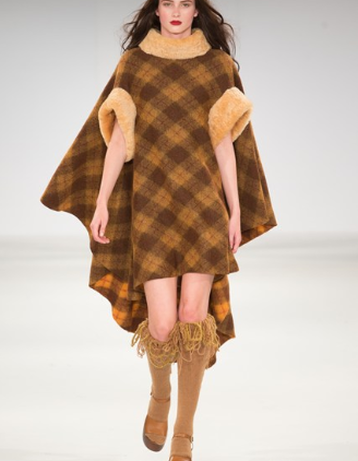 check poncho with fur and fringed socks