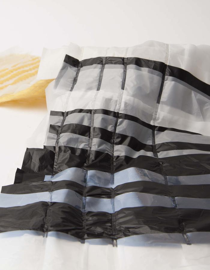 Front: layered, breathable, water repellant textile | bio plastic foil; Back: ultrasonic weave | wool and bio plastic foil.