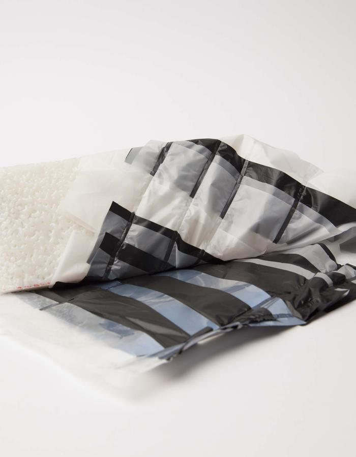 Outside:  layered, breathable, water repellant textile | bio plastic foil; Inside: Pressed PLA.