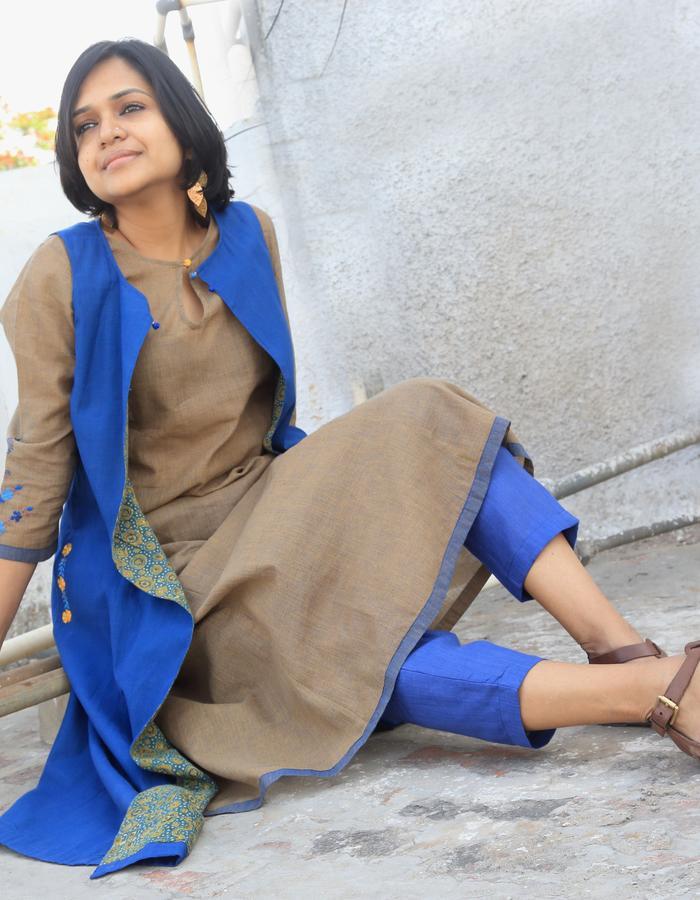 Bani- khadi jacket lined with Ajrakh, embroidery detailing on pocket and back