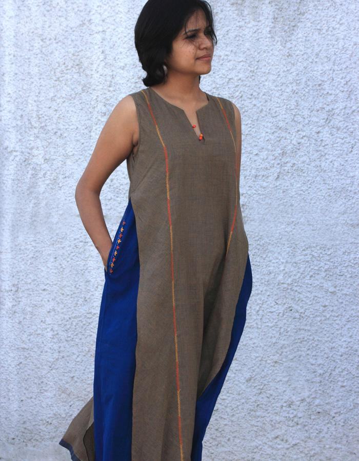 Sharini- layered dress in khadi checks lined with mulmul, embroidery deatil on panel and pocket