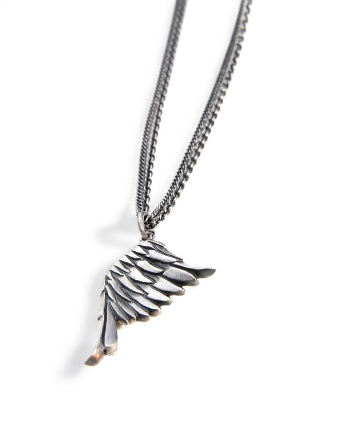 """LITTLE WING - sterling silver eagle's wing pendant is beautifully carved with feather details. Pendant measures approx 25mm long and hangs on a double 18"""" trace and curb chain necklace."""