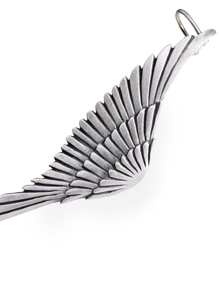 EARRWING - sterling silver ear cuffs worn as pierced earring studs with screw fittings to secure further up the ear. Each piece is beautifully carved with feather detail and measures approx 65mm from wing tip to tail feathers.