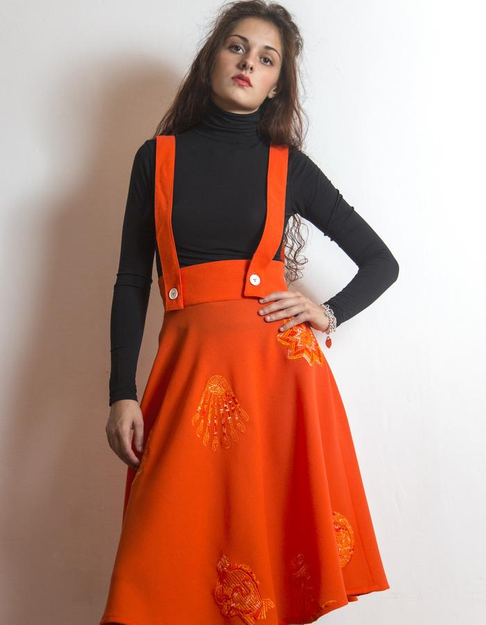 Overall skirt, embroidered crepe wool.