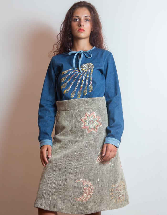 Embroidered pure wool dress.