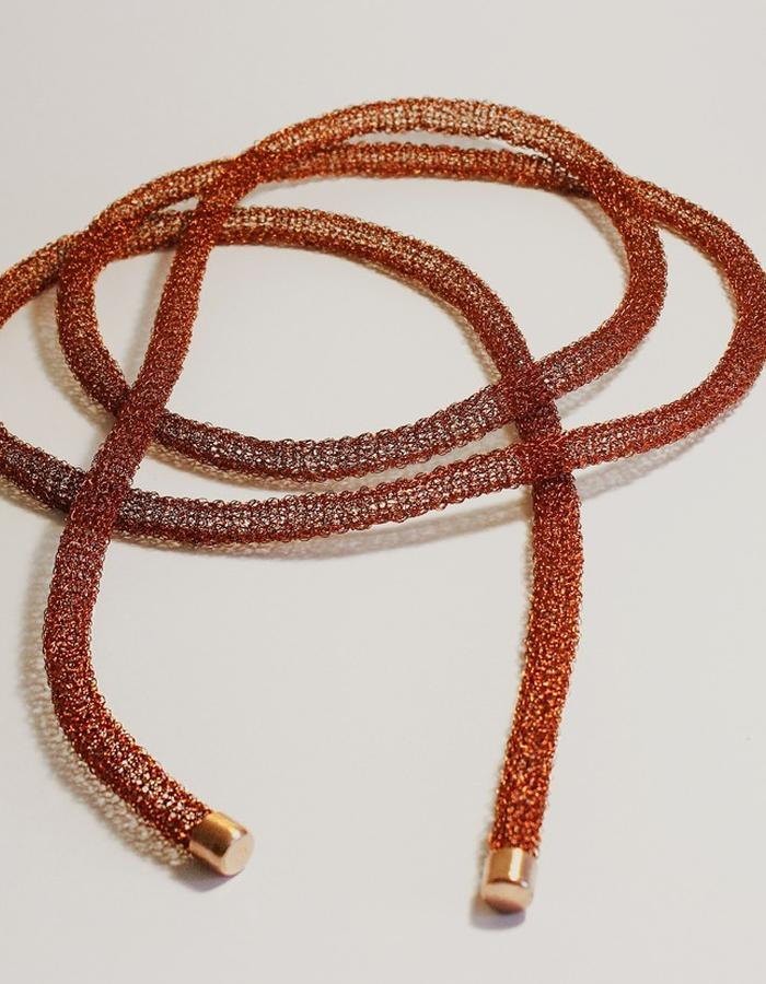 The 0.5 Necklace it´s made of copper