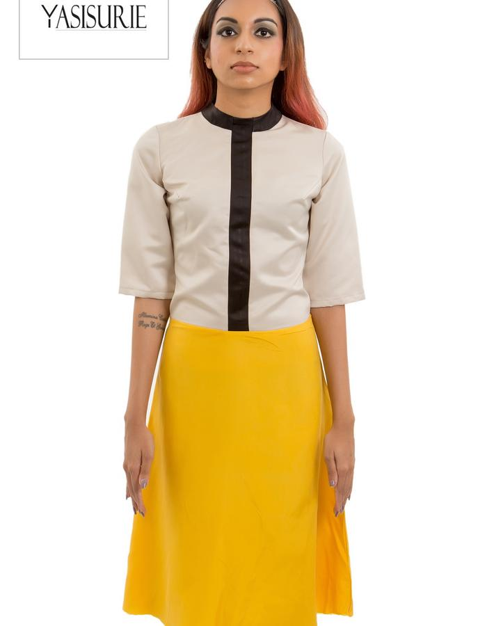 Vertical neck band with a flowey skirt and fitted top