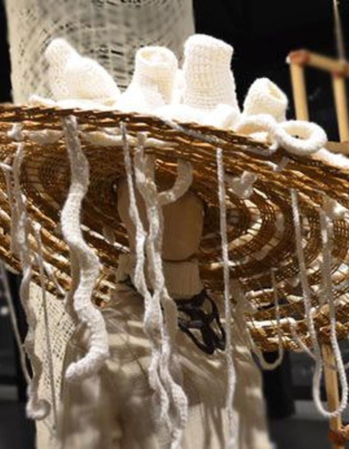 Crocheted details on a giant rattan hat.