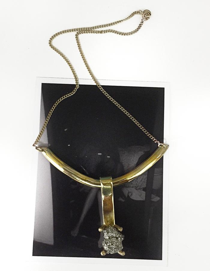 Chiselling necklace with filed chain and Pirite pendant. Gold plated brass