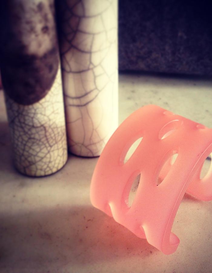 Frosted pink cuff with cut out ellipses