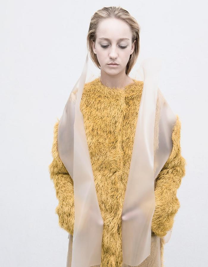 Plastic and polyester fiber coat