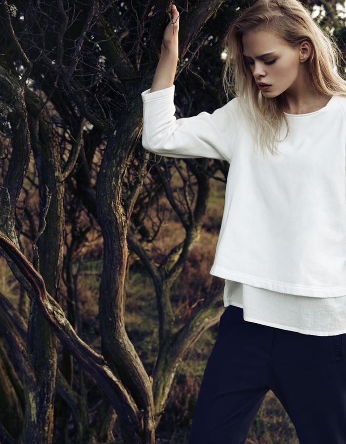 Slightly A-shaped recycled brushed cotton sweatshirt, with lightweight textured cotton layer underneath. Relaxed viscose trousers with elastic waistband, side seams shifted towards front for a flattering illusion.