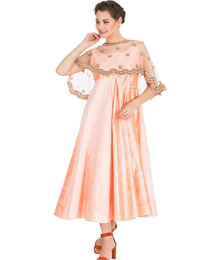 """""""Featuring Peach  Raw Silk Center Inverted Pleated Dress  embroidered with brass flowers,  crystals and pearl. With Cigrette Pants COMPOSITION: raw silk, Net Lining: Butter crepe CARE: Dryclean only.  Measuments ( in inches) M : Bust -  36"""""""", Waist - 28"""""""", Hip - 40"""""""" L: Bust - 38"""""""", Wait -30"""""""", Hip - 42"""""""" Skirt length: 42"""""""""""""""