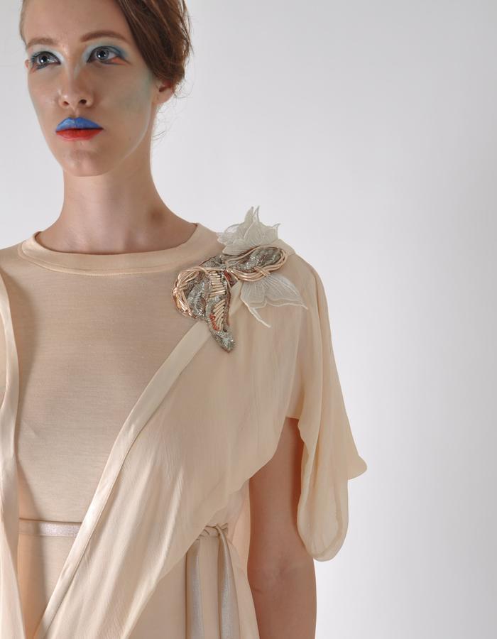 drape with 3-d bird broach  dress.