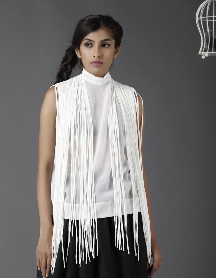 White sleeveless shirt with fringe detailing along the shoulder