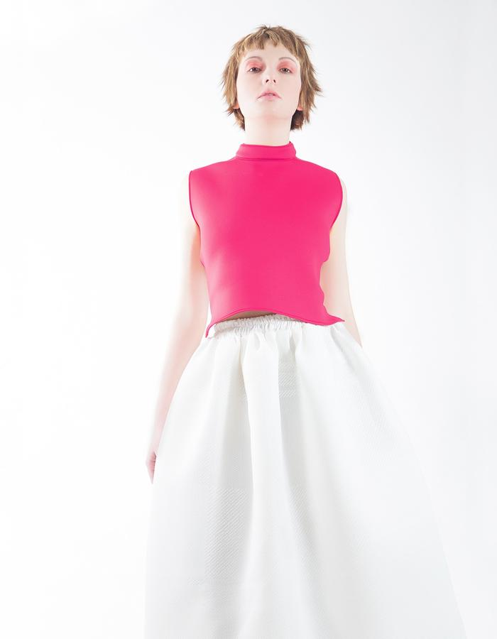 Fuchsia top made in neoprene with printed white on white dress.