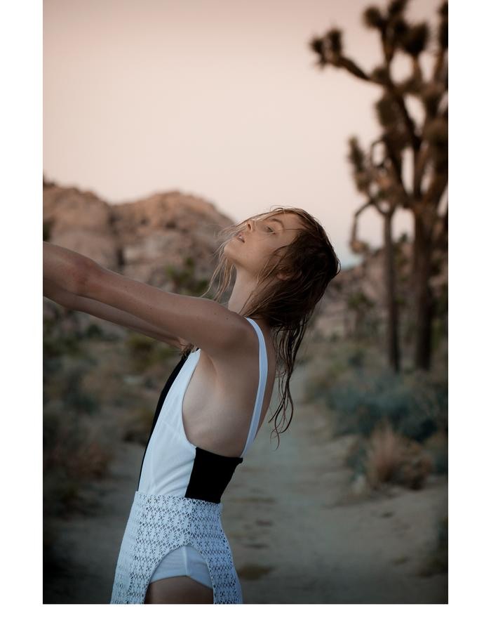 Emily Daccarett two tone bodysuit/ white jersey/plastic skirt